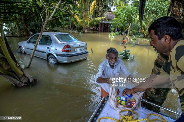 Border Security Force distribute food food and water to residents who are stuck in their houses as well who have not vacated houses at Allapy on...