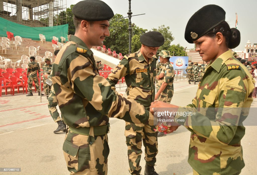 Border Security Force females tying rakhi to their male colleagues` wrists on the occasion of Raksha Bandhan festival at Attar Border near on August..