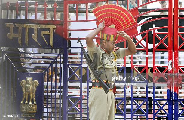 Border Security Force Jawan adjusting his turban during the Beating Retreat Ceremony at Attari Border on September 19 2016 in Amritsar India Each day...
