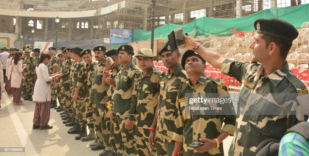 Border Security Force Jawans showing their rakhi on the occasion of Raksha Bandhan festival at Attar Border near on August 7 2017 in Amritsar India...