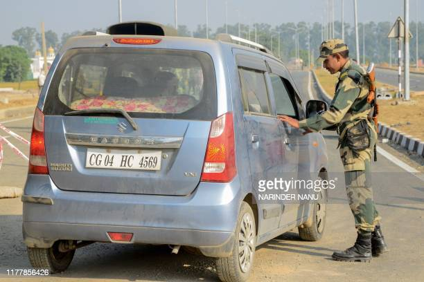 A Border Security Force personnel checks a vehicle at Dera Baba Nanak some 50 kms from Amritsar on October 24 2019 India and Pakistan are set on...