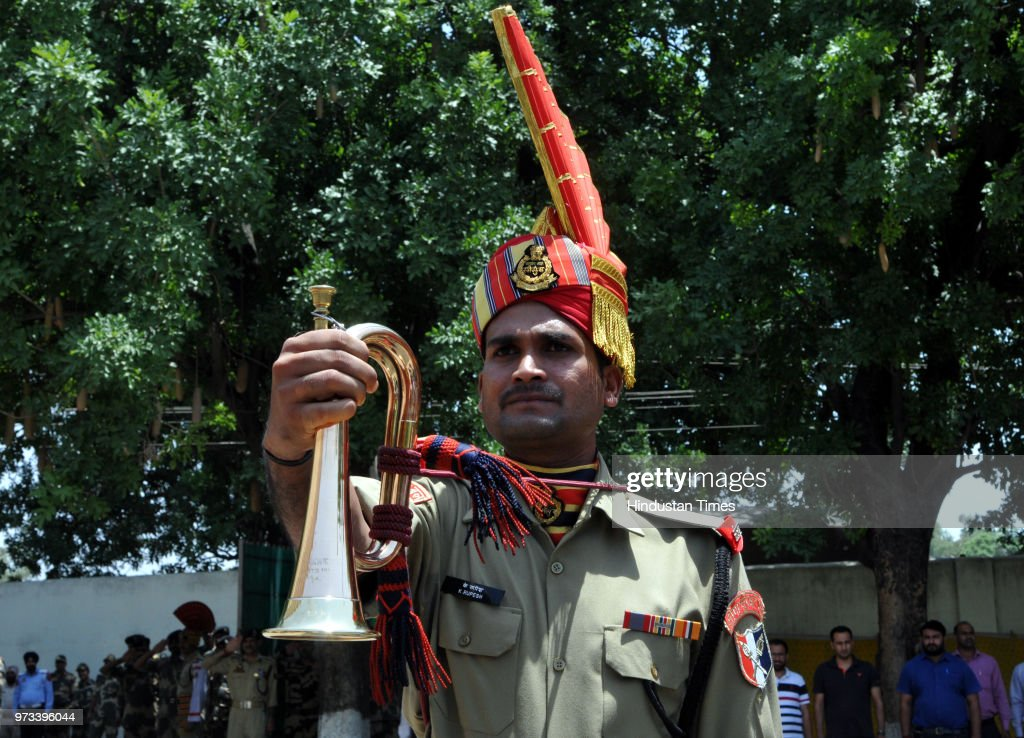 A Border Security Force (BSF) personnel pays tribute to four of their colleagues, killed in cross border firing, at a wreath laying ceremony at Paloura BSF Headquarters on June 13, 2018 in Jammu, India.