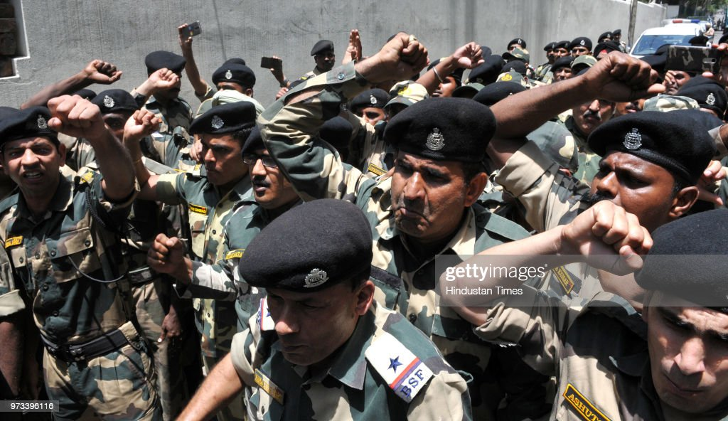 Border Security Force (BSF) personnel raise slogans against Pakistan after paying tribute to four of their colleagues, killed in cross border firing, at a wreath laying ceremony at Paloura BSF Headquarters on June 13, 2018 in Jammu, India.