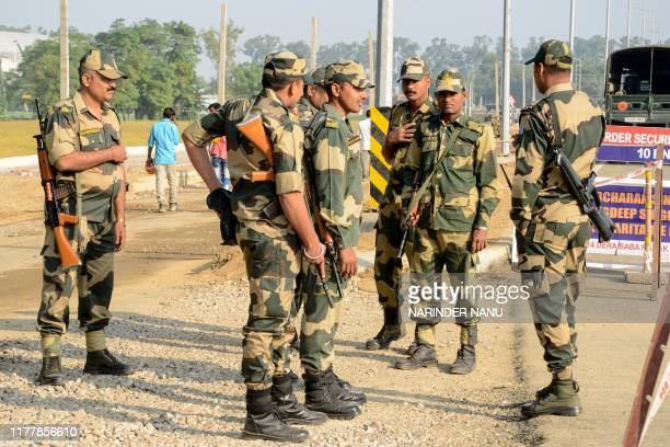 Border Security Force personnel stand guard at Dera Baba Nanak some 50 kms from Amritsar on October 24 2019 India and Pakistan are set on October 24...