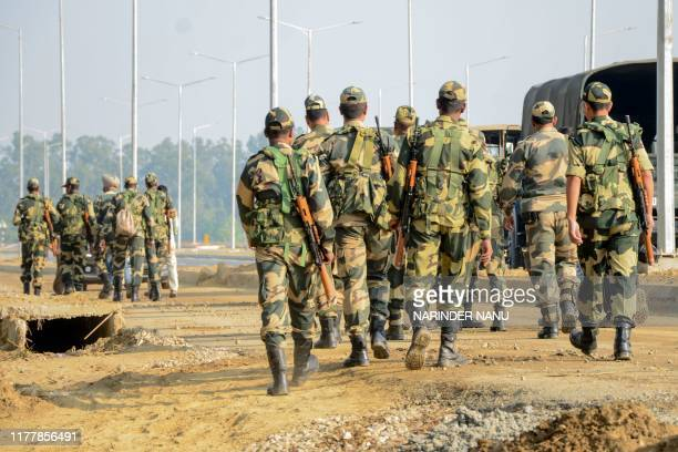 Border Security Force personnel walk as they stand guard at Dera Baba Nanak some 50 kms from Amritsar on October 24 2019 India and Pakistan are set...