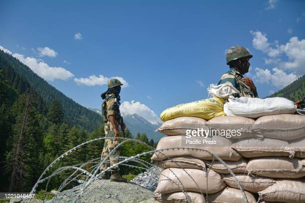 Border Security Force personnels keeping vigil at a checkpoint along a highway leading to Ladakh at Gagangeer Twenty Indian army soldiers including a...