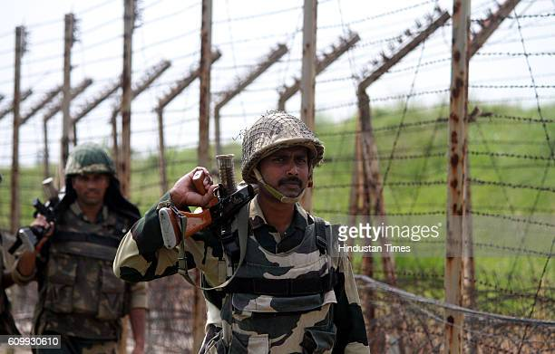 Border Security Force soldiers keep vigil as they are patrolling at International Border about 35 km from Jammu following heightened tensions between...