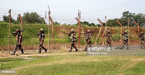 Border Security Force soldiers keep vigil as they patrol at International Border about 35 km from Jammu following heightened tensions between India...