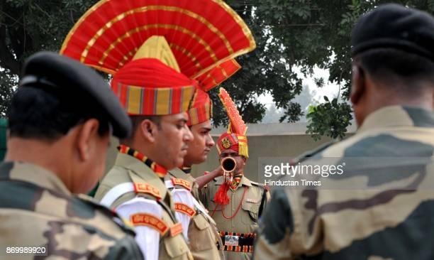 Border Security Force soldiers paying homage to BSF soldier constable Tapan Mondal during a wreathlaying ceremony on November 3 2017 in Jammu India...