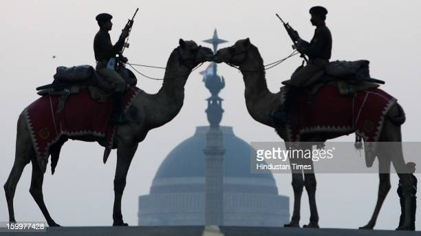 Border Security Force soldiers ride their camels in front of India's presidential palace Rashtrapati Bhavan during a rehearsal for the 'Beating the...