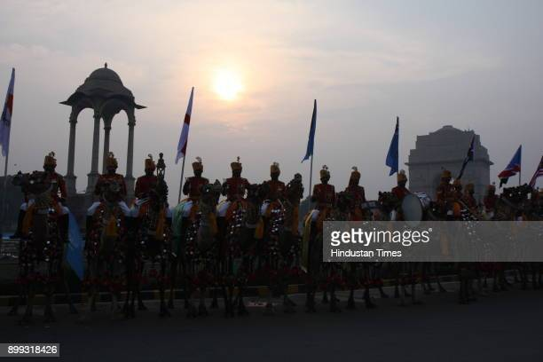 Border Security Force's camelmounted troops and band contingent during a ceremony to launch a logo for The Commonwealth Games '2010' at India Gate in...