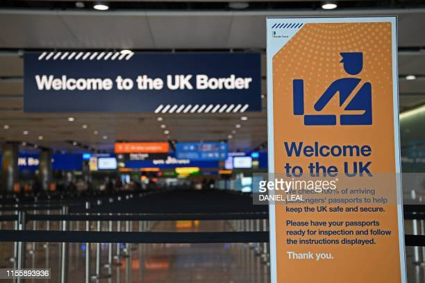 UK border signage is pictured at the passport control in Arrivals in Terminal 2 at Heathrow Airport in London on July 16 2019