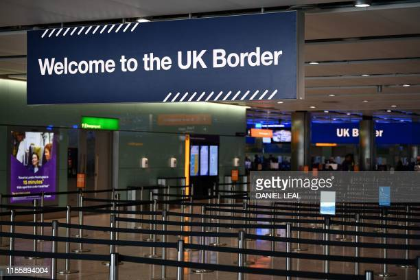 UK border signs are pictured at the passport control in Arrivals in Terminal 2 at Heathrow Airport in London on July 16 2019