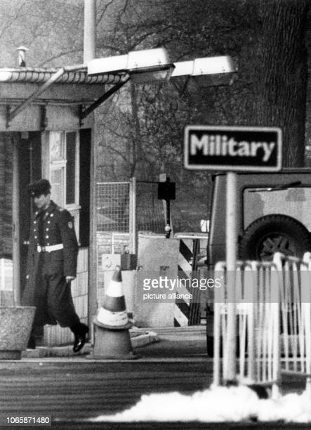 A GDR border soldier exchanges a broken barrier with a traffic cone on Glienicker Bridge between West Berlin and Brandenburg on the 10th of March in...