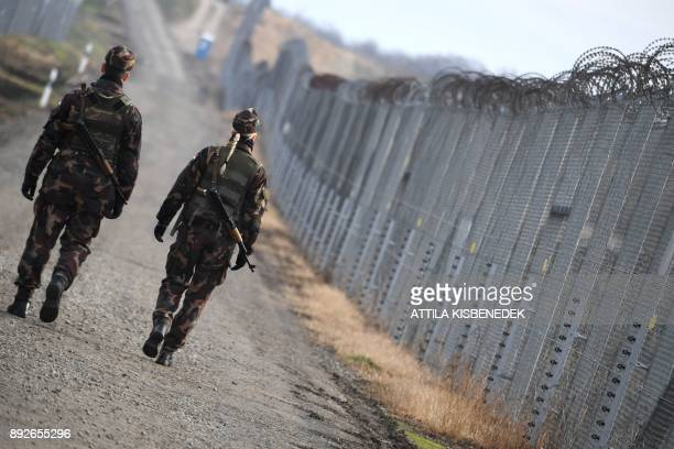 Border soldiers patrol along the border fence at the HungarianSerbian border near Hercegszanto border station on December 14 2017 Since July 2015...