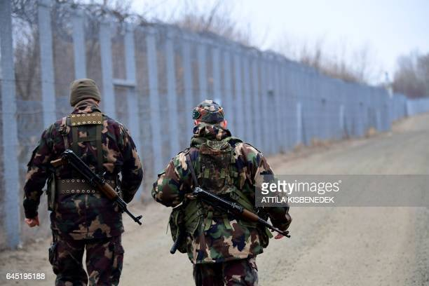 Border soldiers patrol along the border fence on the HungarianSerbian border near the village of Roszke on February 24 2017 The Hungarian defence...