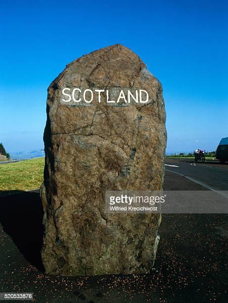 Border stone with the stroke Scotland at Cheviot Hills, Great Britain