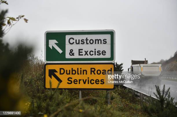Border traffic passes a Customs and Excise signpost on the border between Northern Ireland and the Republic of Ireland on November 19, 2020 in Newry,...