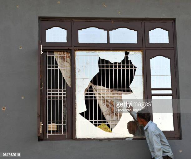 A border villager shows the damaged window of his house by shelling from the Pakistani side of the border in Nanga village of Ramgarh sector on May...