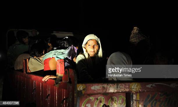 Border villagers along with children carry their belongings as they leave their homes to take shelter in a comunity hall at RS pura about 25 km from...