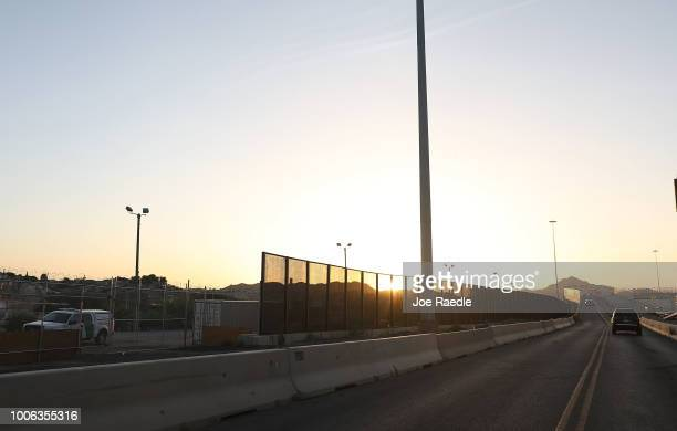 A border wall is seen along a roadway separating the US and Mexico on July 23 2018 in El Paso Texas A courtordered July 26th deadline is approaching...