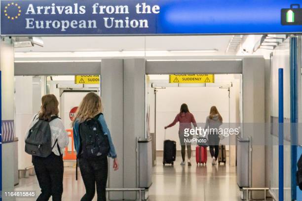 EU UK Borders Passport and European Union signs and inscription in London Stansted STN airport in England UK on 23 August 2019 a few months before...