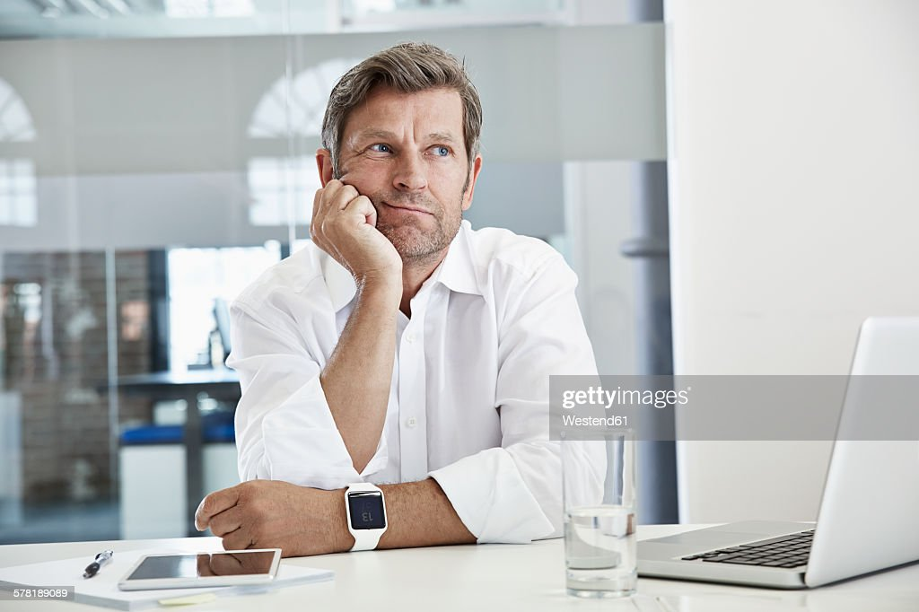 Bored and frustated businessman at desk : Stock Photo