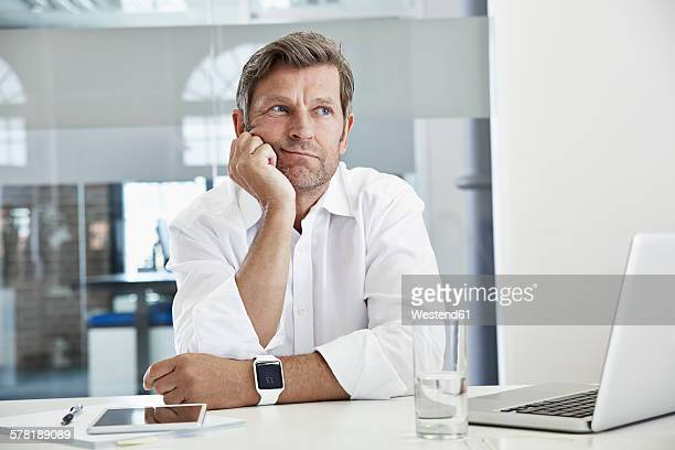 Bored and frustated businessman at desk