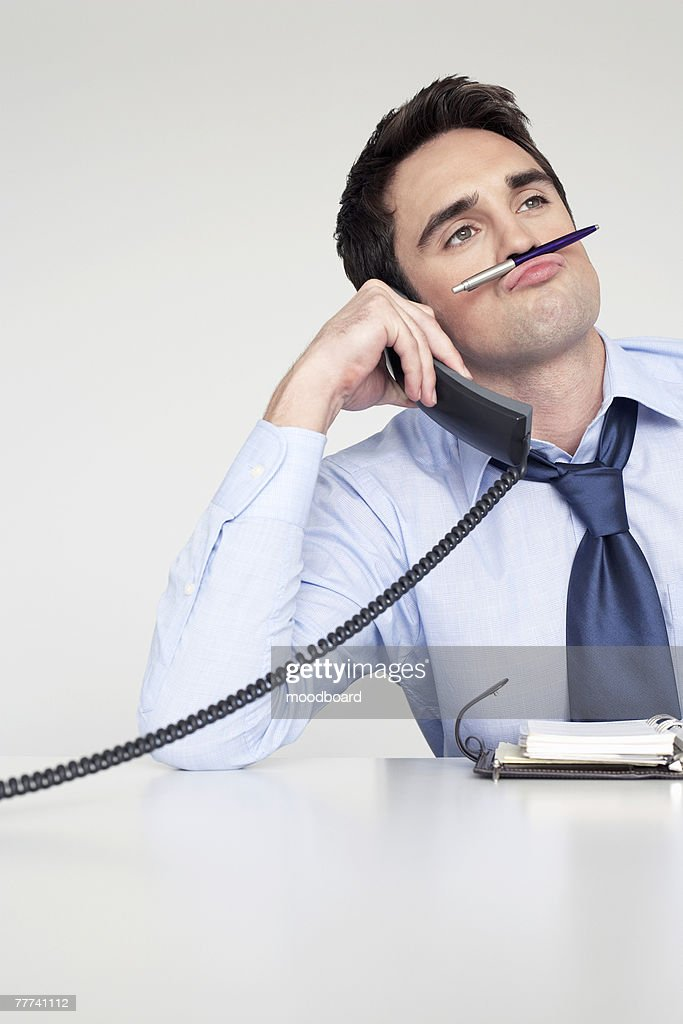 Bored Businessman on Phone : Stock Photo