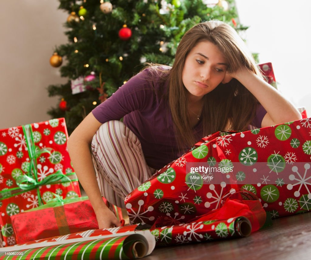 Bored Caucasian Woman Wrapping Christmas Gifts Stock Photo   Getty ...