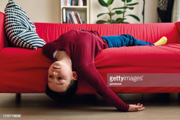 bored child on living room. - boredom stock pictures, royalty-free photos & images