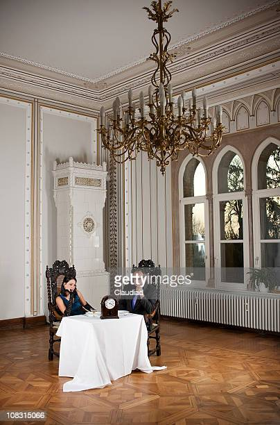 Bored couple in elegant room