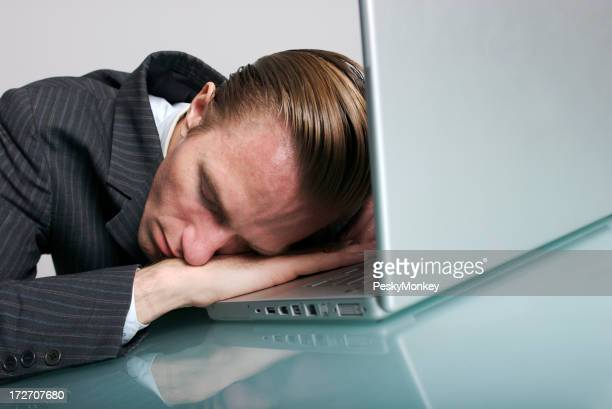 Bored Exhausted Businessman Sleeping at His Desk Laptop