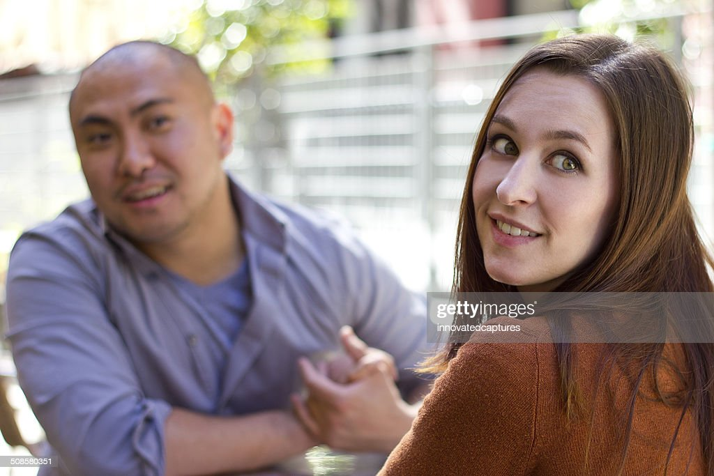 Bored Female on an Outdoor Date Being Rude : Stock Photo