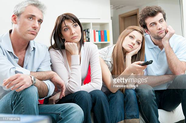 Bored friends watching at TV