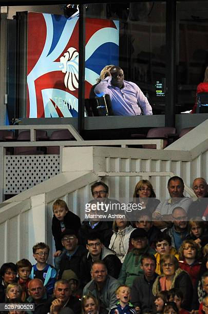 A bored Garth Crooks of BBC Television watches the game from the TV studio