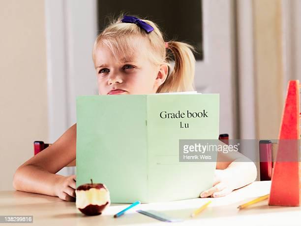 Bored girl doing homework at desk