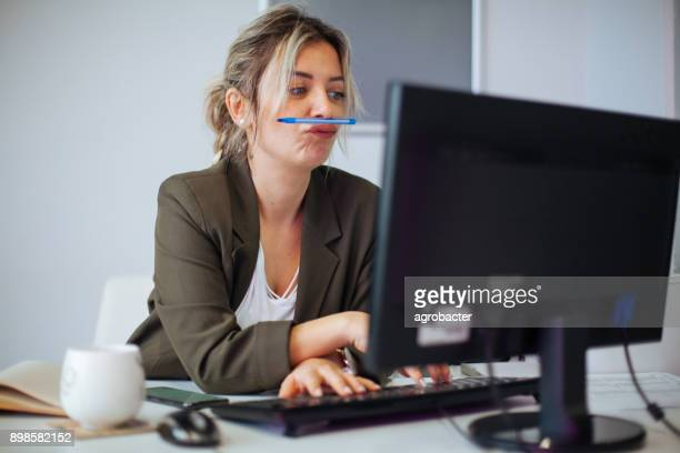 bored or incompetent businesswoman at work - wasting time stock pictures, royalty-free photos & images