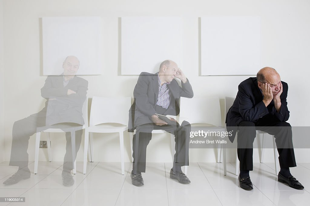 Bored senior man passing time in a waiting room : Stock Photo