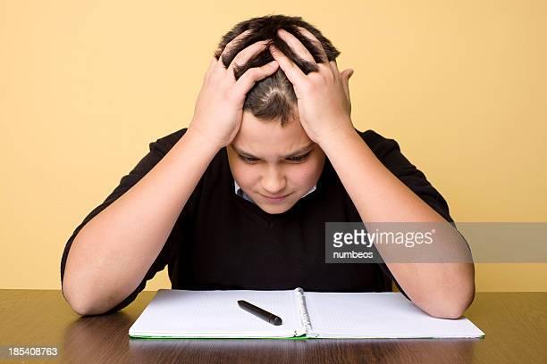 Bored teenage boy doing homework