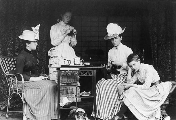 A bored teenage girl at a Victorian tea party, circa...