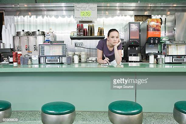 bored waitress in a diner - diner stock pictures, royalty-free photos & images