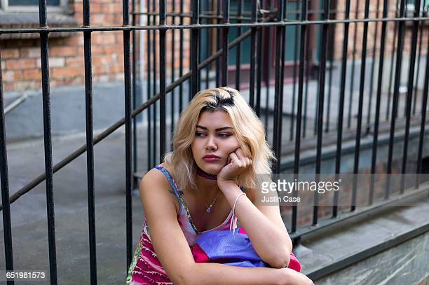 bored woman waiting for boyfriend - sulking stock pictures, royalty-free photos & images