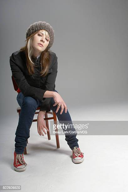 Bored young woman sitting on a chair