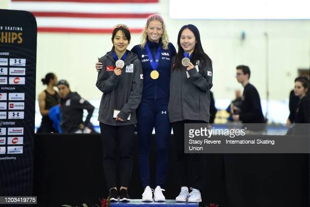 Bo-Reum Kim of Korea, Mia Kilburg-Manganello of the United States and Ji Woo Park of Korea stand on the podium following the Ladies Mass Start during...