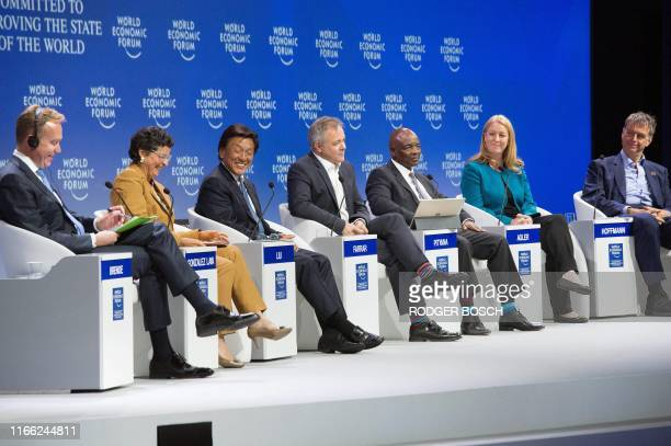 Borge Brende, president of the World Economic Forum, Arancha Gonzalez Laya, executive director of the International Trade Centre , Alex Liu, managing...