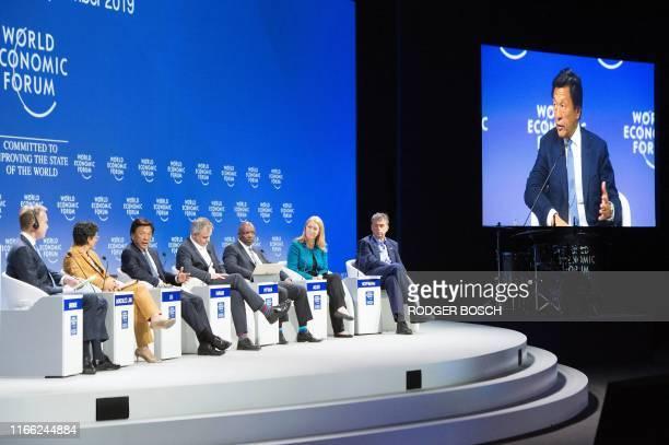 Borge Brende president of the World Economic Forum Arancha Gonzalez Laya executive director of the International Trade Centre Alex Liu managing...