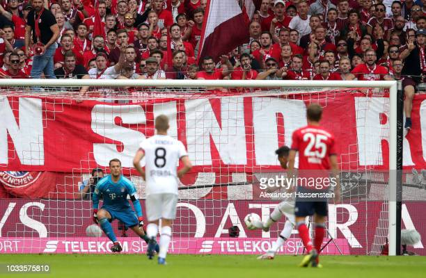 Borges Wendell of Bayer 04 Leverkusen scores his team's first goal from a penalty during the Bundesliga match between FC Bayern Muenchen and Bayer 04...