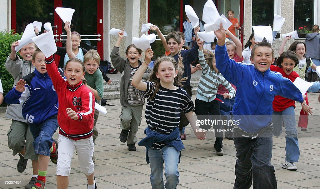 Children from the Borgsdorf primary school run out of their class rooms cheering after receiving their end-of-term exam results 11 July 2007 in the eastern German town of Borgsdorf. Thousands of German school children received their results marking the start of the school summer holidays.