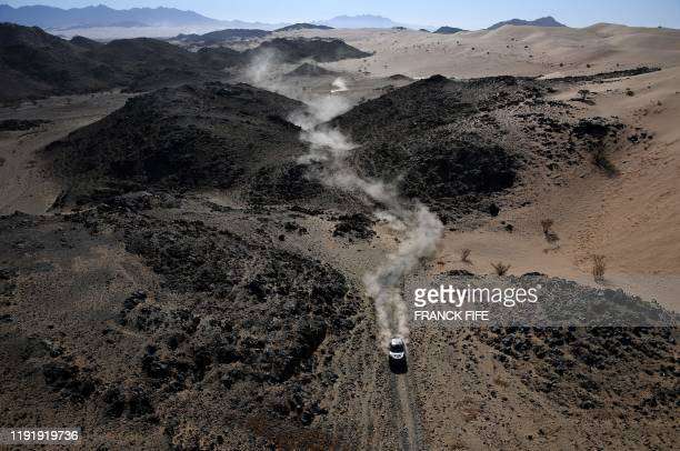 Borgward's Rally team driver Nani Roma of Spain and codriver Daniel Carreras Oliveras of Spain compete during the Stage 1 of the Dakar 2020 between...